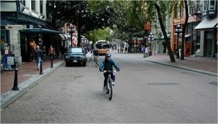 boy biking low speed street